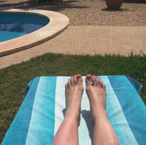 feet on a sunbed